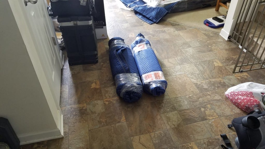 The Delivery service first unboxes your table and inspects all the pieces, then wraps them in furniture pads for shipping to your home. Here are the wrapped legs of a Tablezilla.