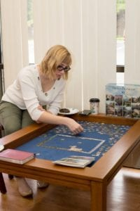 Great for jigsaw puzzles! Coffee Game Table in Elm finish and Dark Blue fabric.