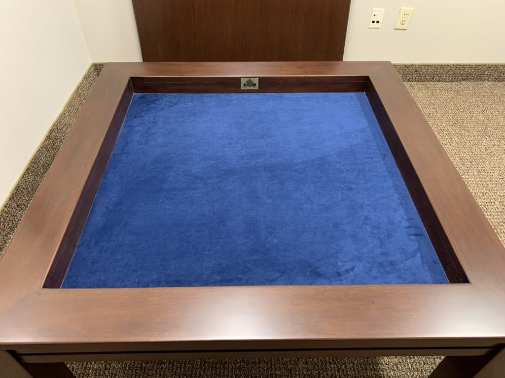 Kitchen Gaming Table at coffee height with Sagamore Hill finish and dark blue fabric
